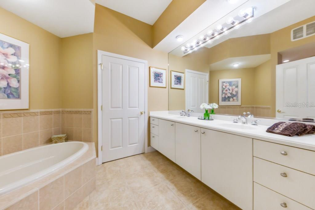 The Master Bath offers His and Her sinks, a private water closet, a large soaking tub and a walk-in tiled shower. The tank-less water heated provides end-less hot water for your soaking pleasures. - Condo for sale at 7504 Botanica Pkwy #101, Sarasota, FL 34238 - MLS Number is A4213208