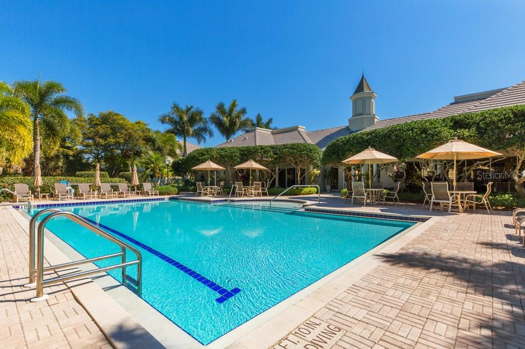 Main Club House with a lap lane in the pool - Condo for sale at 7504 Botanica Pkwy #101, Sarasota, FL 34238 - MLS Number is A4213208