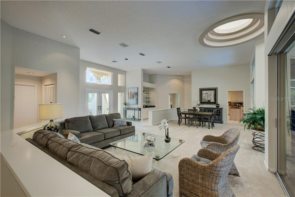 Spacious living area with elevated ceilings - Single Family Home for sale at 3896 Boca Pointe Dr, Sarasota, FL 34238 - MLS Number is A4213831