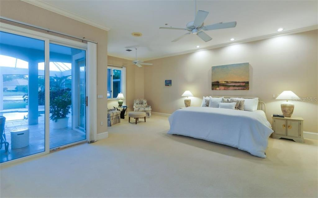 The Master Bedroom Wing Includes a Sitting Area Overlooking the Lanai and Lake; a Very Large Walk-Through Closet. - Single Family Home for sale at 367 Sugar Mill Dr, Osprey, FL 34229 - MLS Number is A4213856