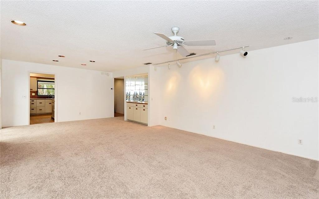 Living room looking into the Kitchen - Condo for sale at 3440 Gulf Of Mexico Dr #8, Longboat Key, FL 34228 - MLS Number is A4214047