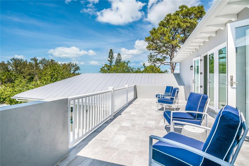 Oversized Upper Terrace - Single Family Home for sale at 601 Triton Bnd, Longboat Key, FL 34228 - MLS Number is A4215179
