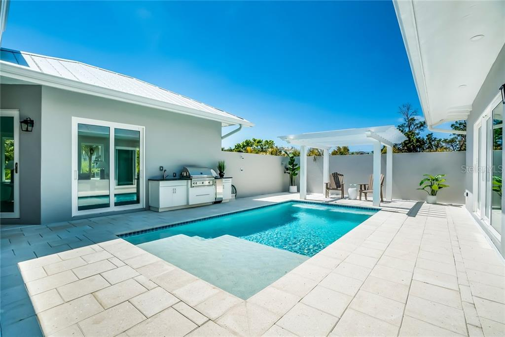 Courtyard Kitchen - Single Family Home for sale at 601 Triton Bnd, Longboat Key, FL 34228 - MLS Number is A4215179
