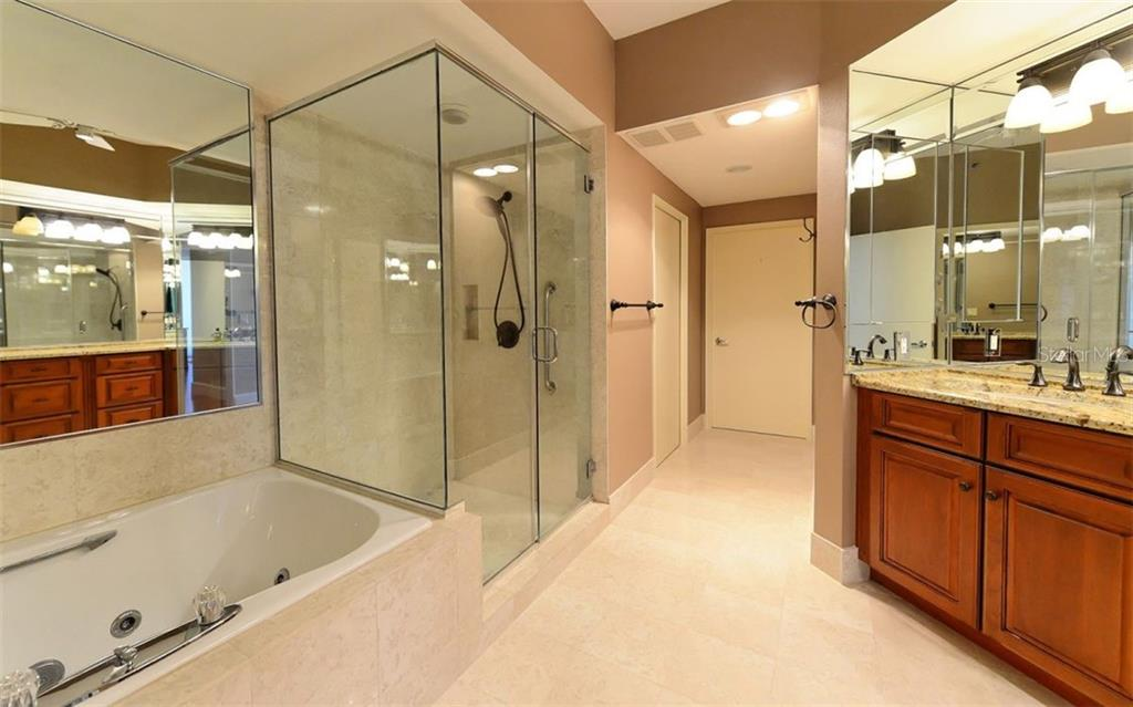 Master bathroom with his and her bathrooms - Condo for sale at 3040 Grand Bay Blvd #252, Longboat Key, FL 34228 - MLS Number is A4402747
