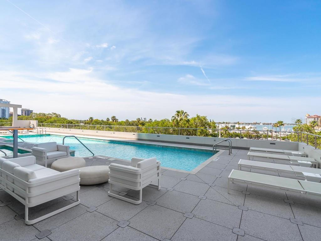 Community Pool with the most impressive water views. - Condo for sale at 1301 Main St #1001, Sarasota, FL 34236 - MLS Number is A4402790