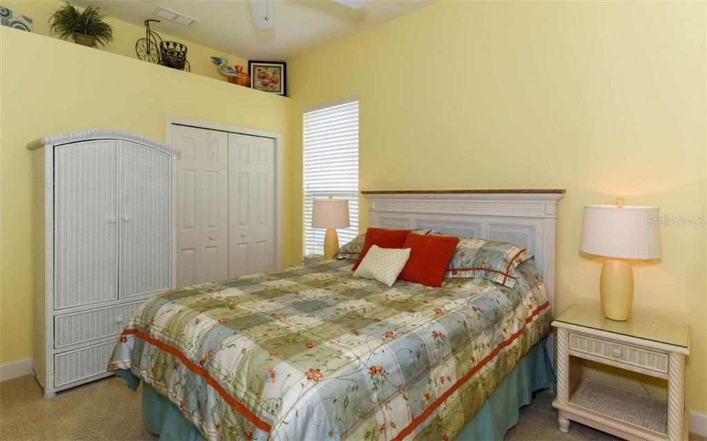 Bedroom 4 with a full bath, perfect guest suite. - Single Family Home for sale at 506 River Crane St, Bradenton, FL 34212 - MLS Number is A4403278