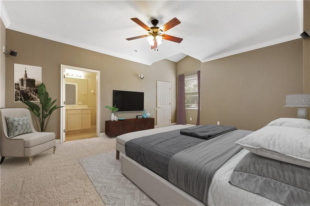Virtually staged.  Huge bedroom at front of unit has a private bath.  Can also be used as media room as it is set up with wiring and speakers.  Walk-in closet. - Condo for sale at 6540 Moorings Point Cir #202, Lakewood Ranch, FL 34202 - MLS Number is A4403403