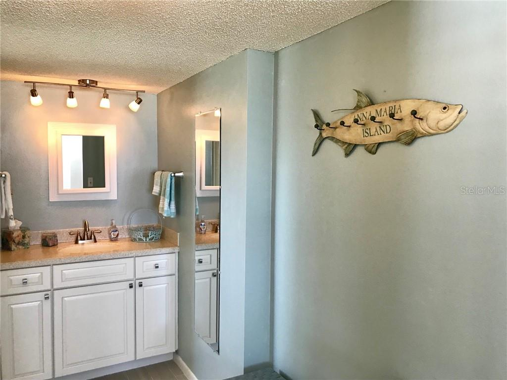 Updated master bath with granite counter top and new cabinetry. - Condo for sale at 5200 Gulf Dr #101, Holmes Beach, FL 34217 - MLS Number is A4404016