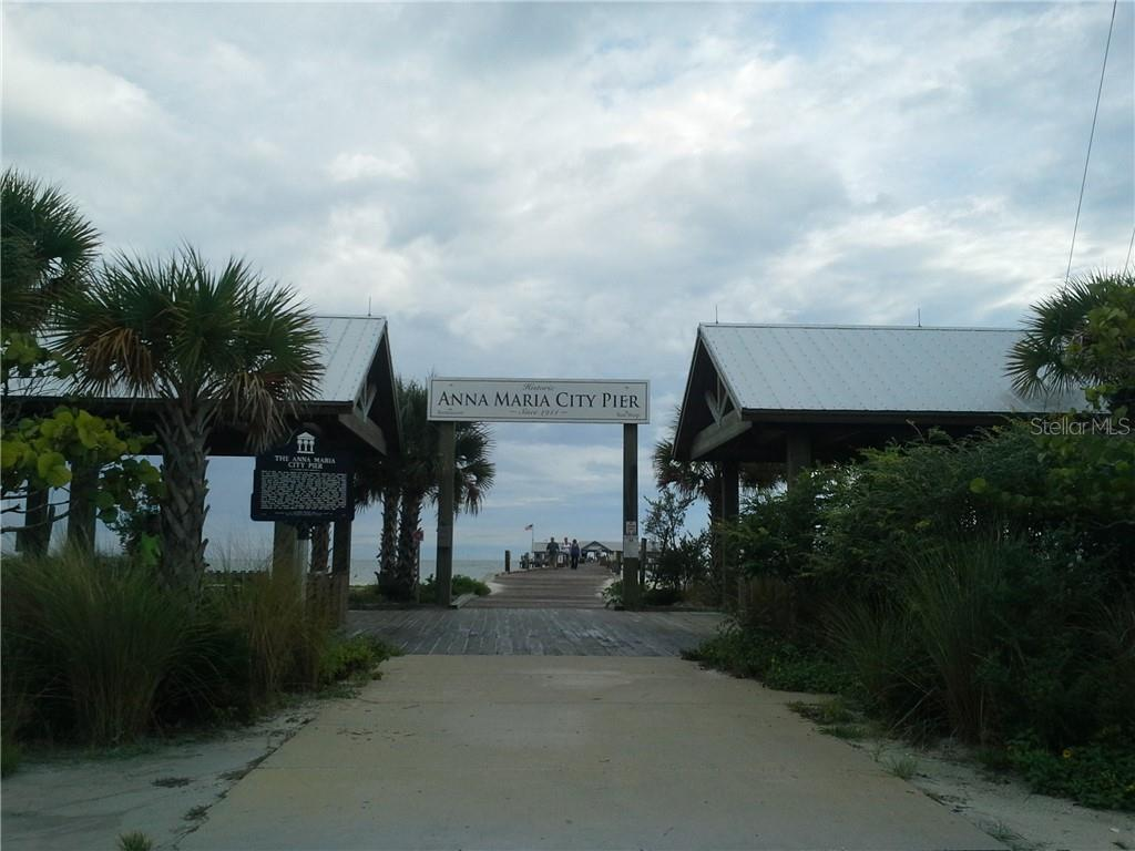 Anna Maria City Pier is currently closed. You'll love taking a walk with your ice cream cone once it reopens. - Condo for sale at 5200 Gulf Dr #101, Holmes Beach, FL 34217 - MLS Number is A4404016