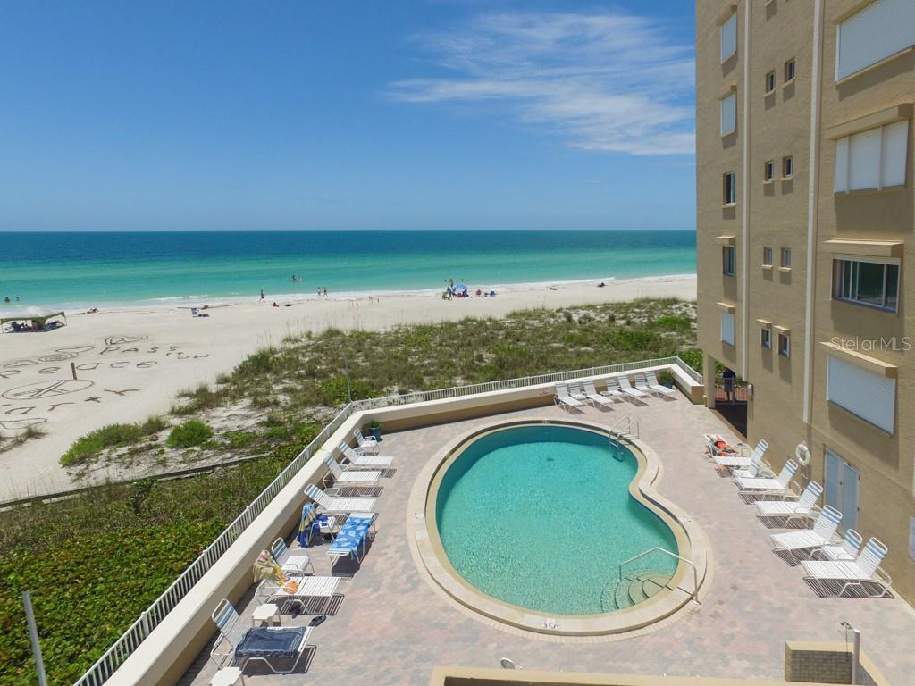 Heated pool adjacent to the beautiful sandy beaches of Holmes Beach. - Condo for sale at 5200 Gulf Dr #101, Holmes Beach, FL 34217 - MLS Number is A4404016
