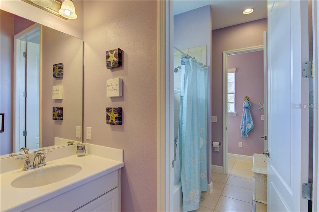 Jack & Jill bath with separate vanities. - Single Family Home for sale at 8139 37th Avenue Cir W, Bradenton, FL 34209 - MLS Number is A4404272