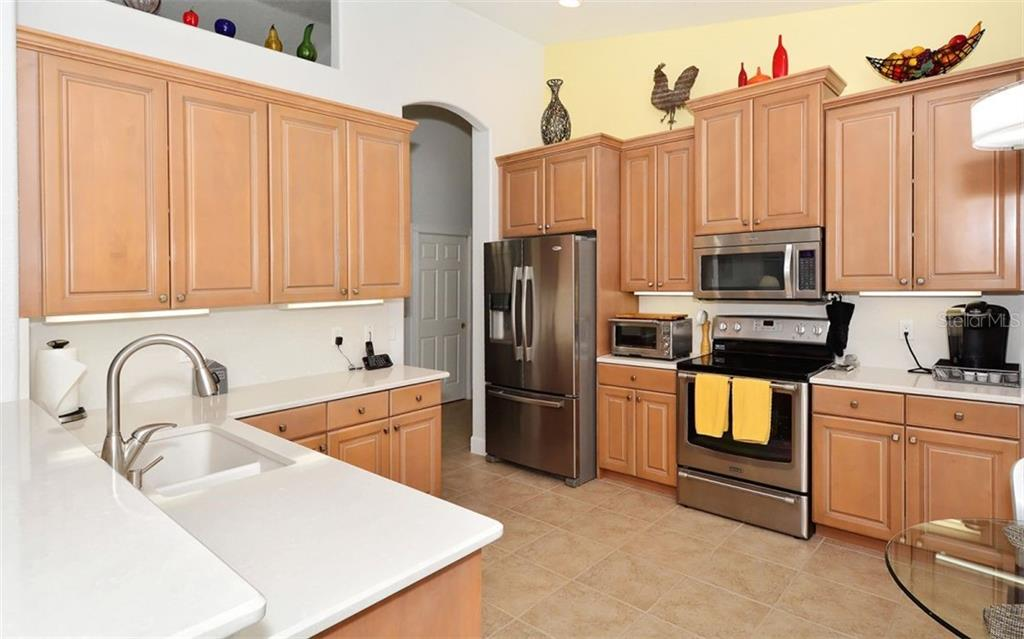 kitchen - Single Family Home for sale at 6507 42nd St E, Sarasota, FL 34243 - MLS Number is A4404611