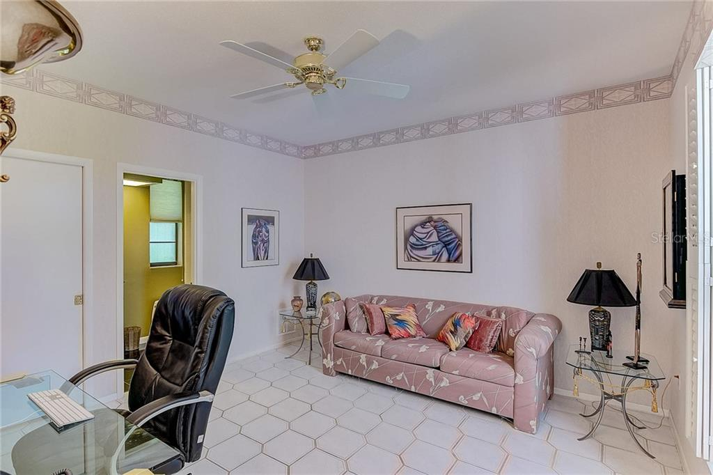 Fourth Bedroom Ensuite, walk-in closet & Office - Single Family Home for sale at 3911 Spyglass Hill Rd, Sarasota, FL 34238 - MLS Number is A4404657