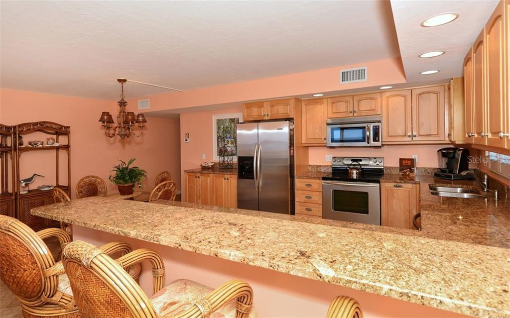 Large open kitchen, Dining area, Can lighting. - Condo for sale at 4311 Gulf Of Mexico Dr #601, Longboat Key, FL 34228 - MLS Number is A4405195