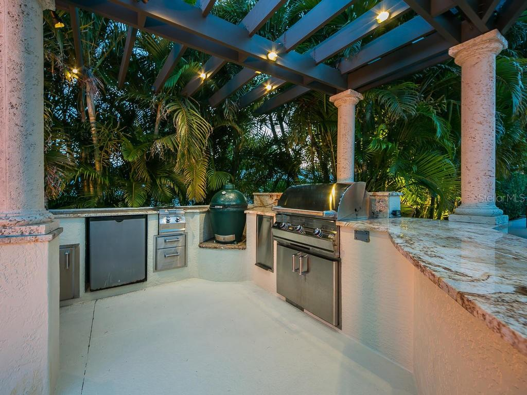 Outdoor kitchen with all of the accoutrements that one would need. - Single Family Home for sale at 301 Bayview Pkwy, Nokomis, FL 34275 - MLS Number is A4405265