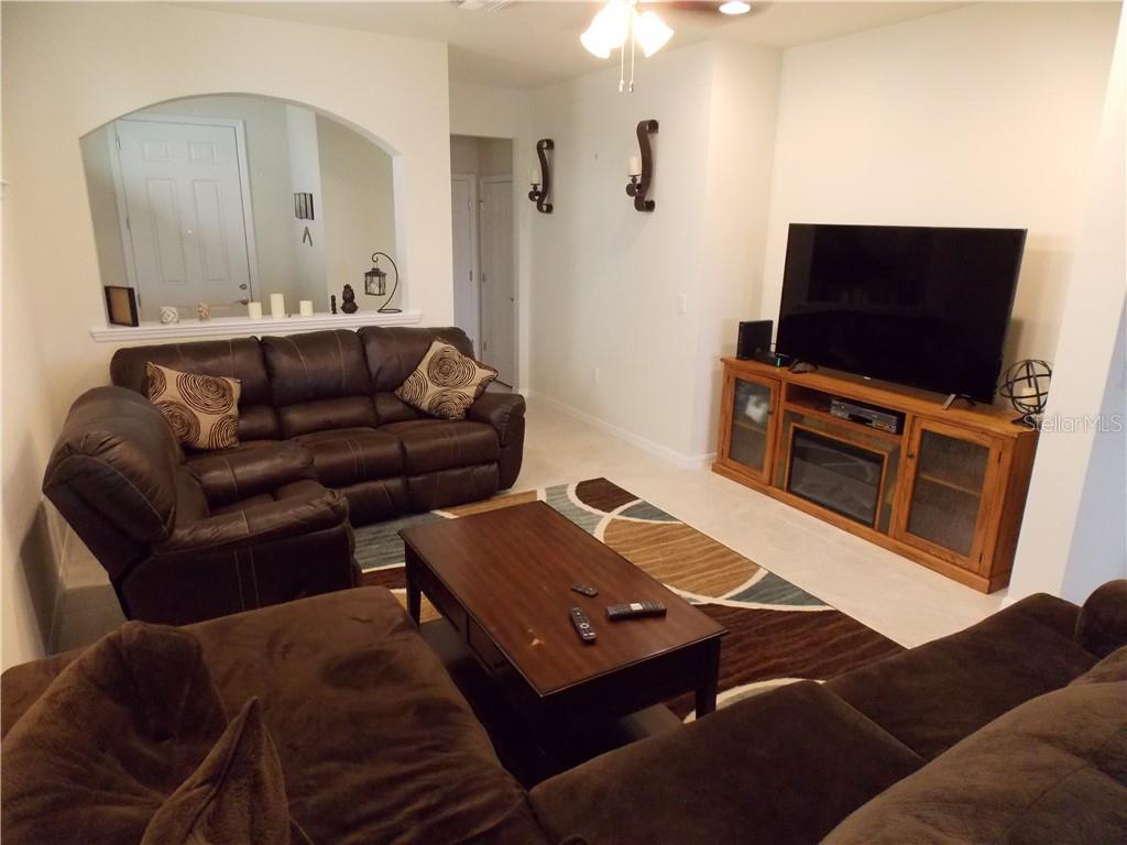 Living room - Single Family Home for sale at 13845 Alafaya St, Venice, FL 34293 - MLS Number is A4405755