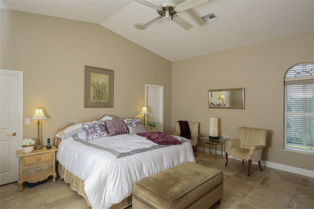 Master Bedroom with walk-thru closet behind bed - Single Family Home for sale at 1778 Bayshore Dr, Englewood, FL 34223 - MLS Number is A4405962