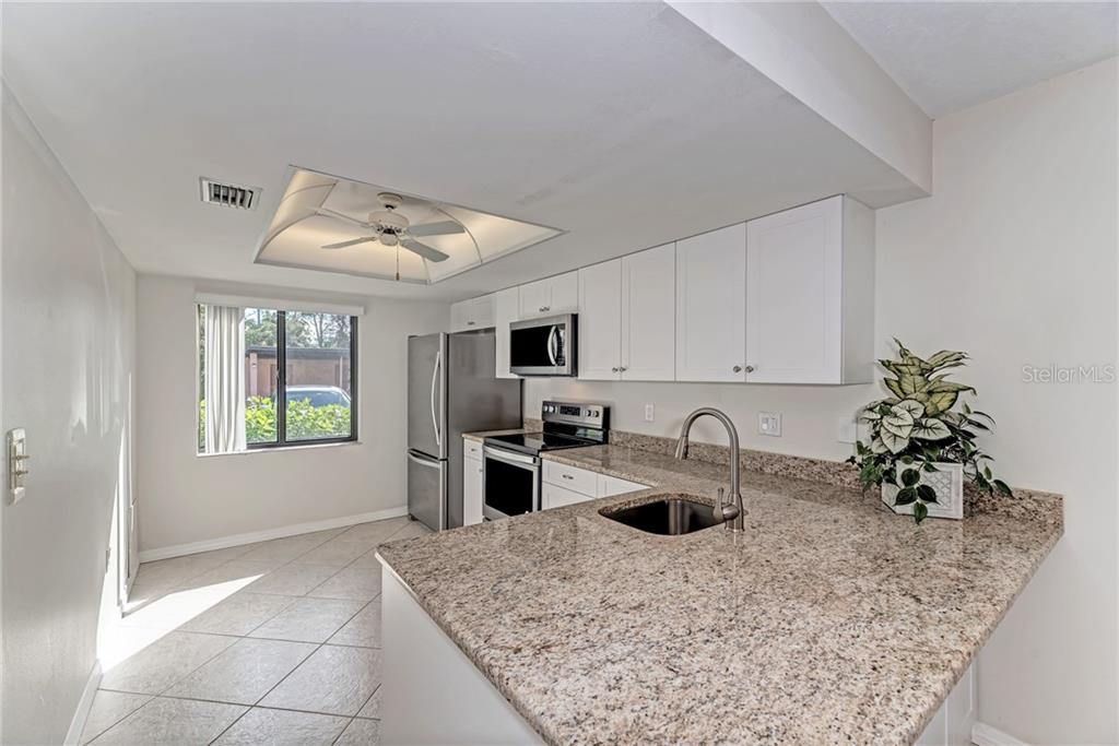Gorgeous brand new kitchen with white shaker cabinets, granite counters and stainless steel appliances with warranty - Condo for sale at 7670 Eagle Creek Dr, Sarasota, FL 34243 - MLS Number is A4406667