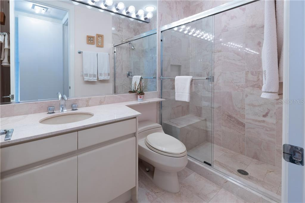 Bath 2 is ensuite Bedroom 2. - Condo for sale at 435 L Ambiance Dr #k806, Longboat Key, FL 34228 - MLS Number is A4406683
