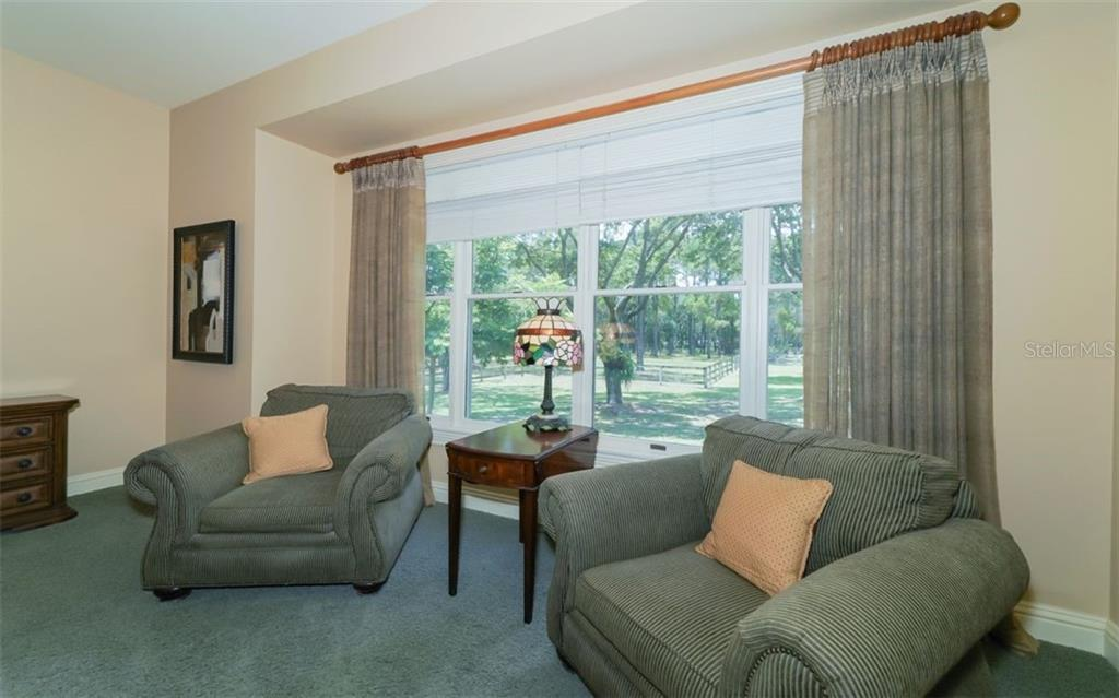 Great relaxing and reading corner in master suite with a serene window view! - Single Family Home for sale at 7866 Saddle Creek Trl, Sarasota, FL 34241 - MLS Number is A4407172