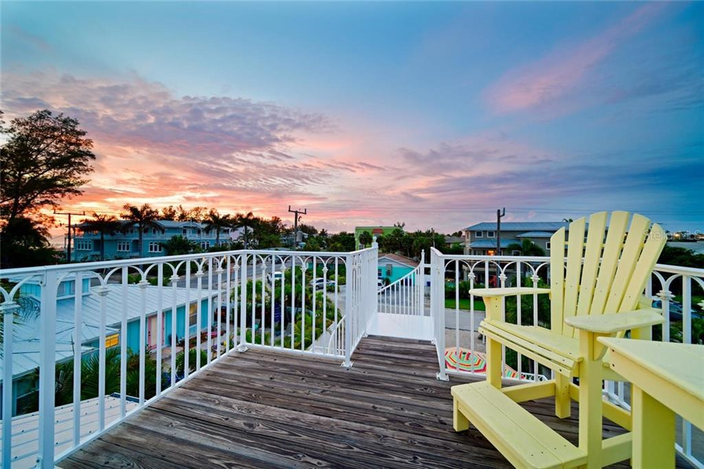 A spiral staircase rises to a crow's nest several feet above the metal roof.  This is the place for beautiful sunsets and daytime gulf views. - Single Family Home for sale at 113 36th St, Holmes Beach, FL 34217 - MLS Number is A4407267