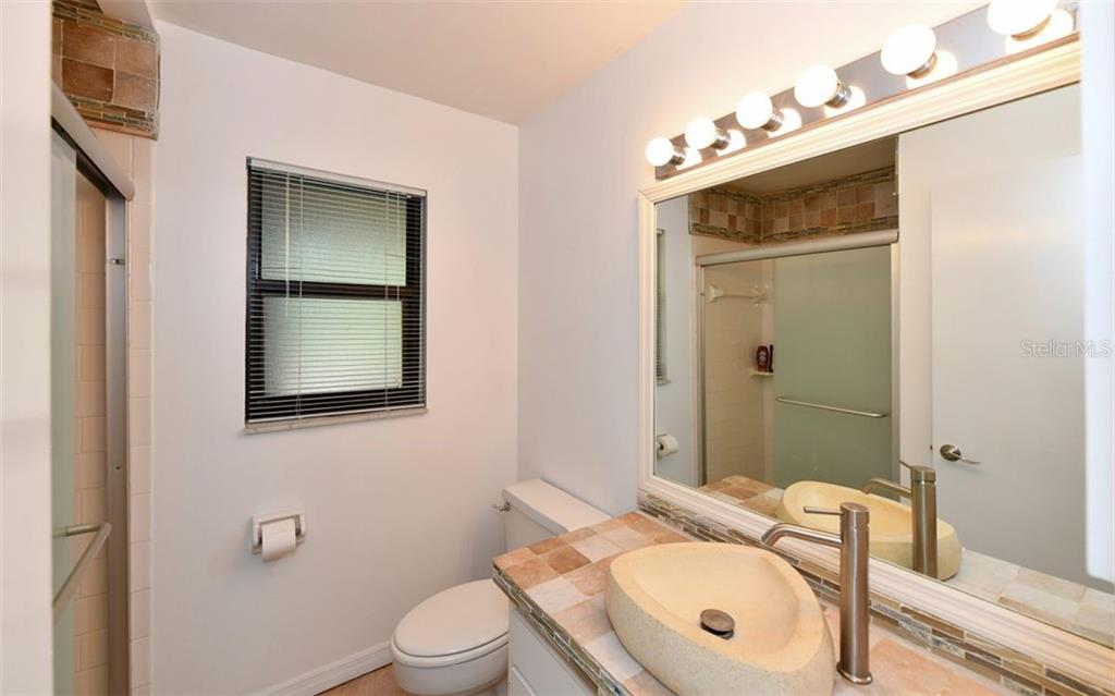 First Floor Bath Room - Single Family Home for sale at 1238 Sea Plume Way, Sarasota, FL 34242 - MLS Number is A4408272