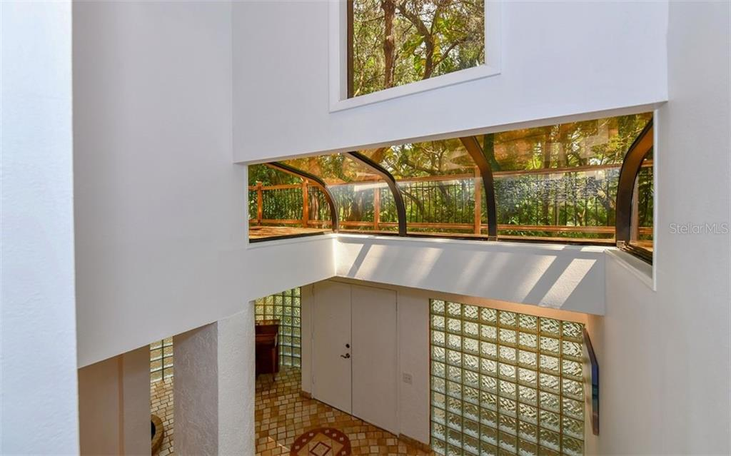 Curved Skylight in 2 Story Open Foyer - Single Family Home for sale at 1238 Sea Plume Way, Sarasota, FL 34242 - MLS Number is A4408272