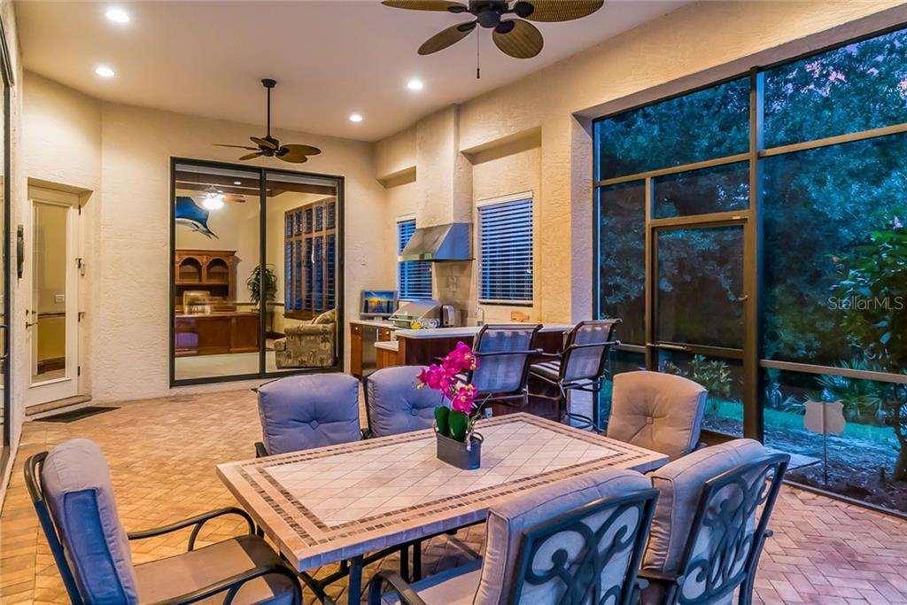 Enjoy fantastic dining at your covered outdoor dining - Florida living at its best! - Single Family Home for sale at 13223 Palmers Creek Ter, Lakewood Ranch, FL 34202 - MLS Number is A4408290