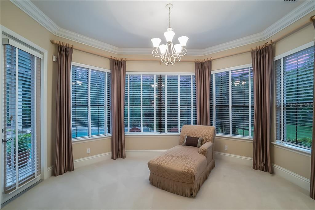 Sitting area of the Master Bedroom, features expansive views of the pool and preserve - door opens to the pool! - Single Family Home for sale at 13223 Palmers Creek Ter, Lakewood Ranch, FL 34202 - MLS Number is A4408290