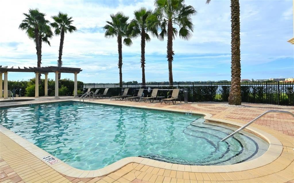Community Pool overlooking the Lake - Condo for sale at 6465 Watercrest Way #403, Lakewood Ranch, FL 34202 - MLS Number is A4409044