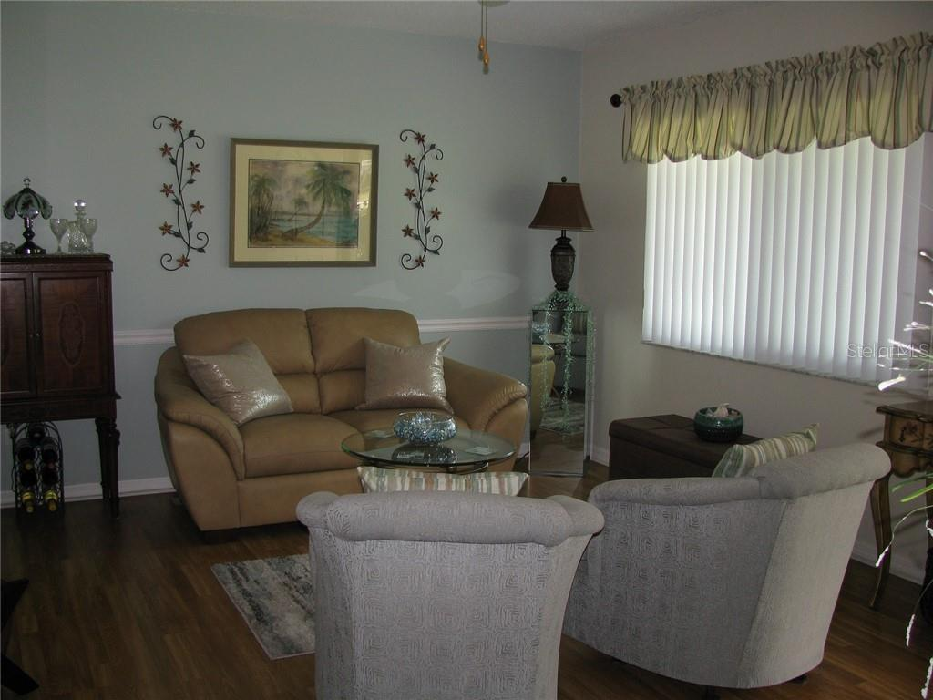 Beautiful living room features laminate flooring. Hurricane windows installed in 2013-2014, - Single Family Home for sale at 1911 29th St W, Bradenton, FL 34205 - MLS Number is A4409585