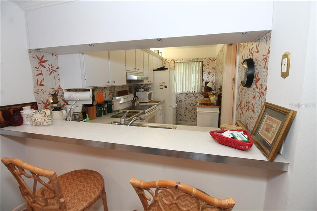 KITCHEN PASS THROUGH - Condo for sale at 1720 Glenhouse Dr #gl 429, Sarasota, FL 34231 - MLS Number is A4409763