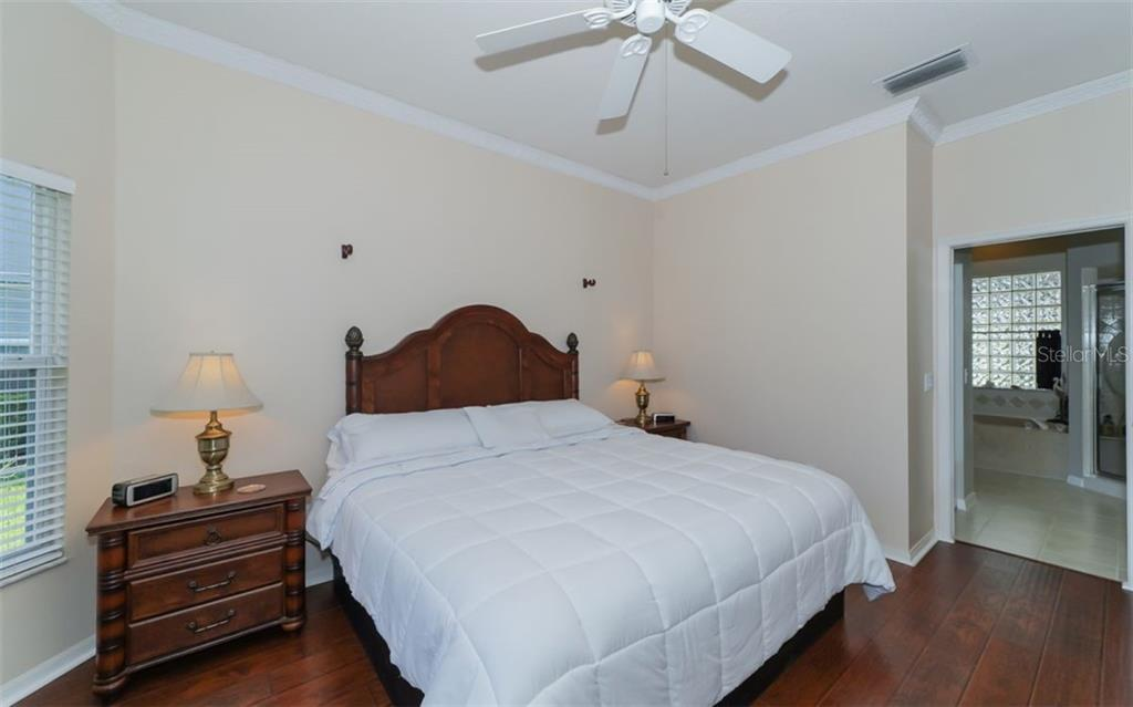 Master bedroom looking into private bath. - Single Family Home for sale at 7808 48th Pl E, Bradenton, FL 34203 - MLS Number is A4410843