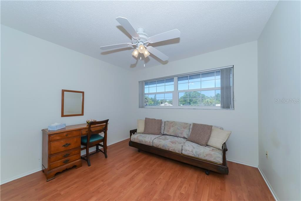 Living Room - Single Family Home for sale at 5591 Cape Aqua Dr, Sarasota, FL 34242 - MLS Number is A4411099