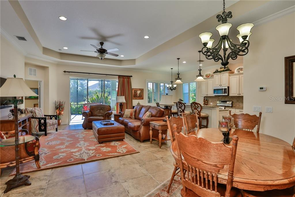 Another view from the great room looking into the dining room and kitchen. - Single Family Home for sale at 11508 Griffith Park Ter, Bradenton, FL 34211 - MLS Number is A4412167