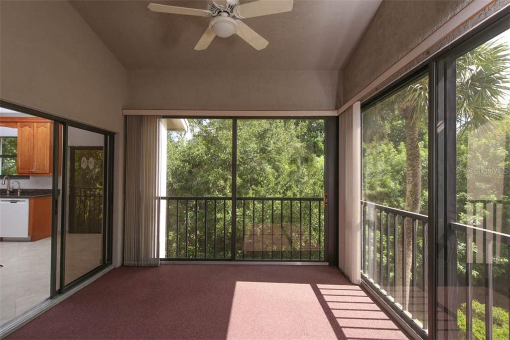 Glass enclosed, the Florida room is a sunny retreat. - Condo for sale at 1716 Starling Dr #204, Sarasota, FL 34231 - MLS Number is A4412237
