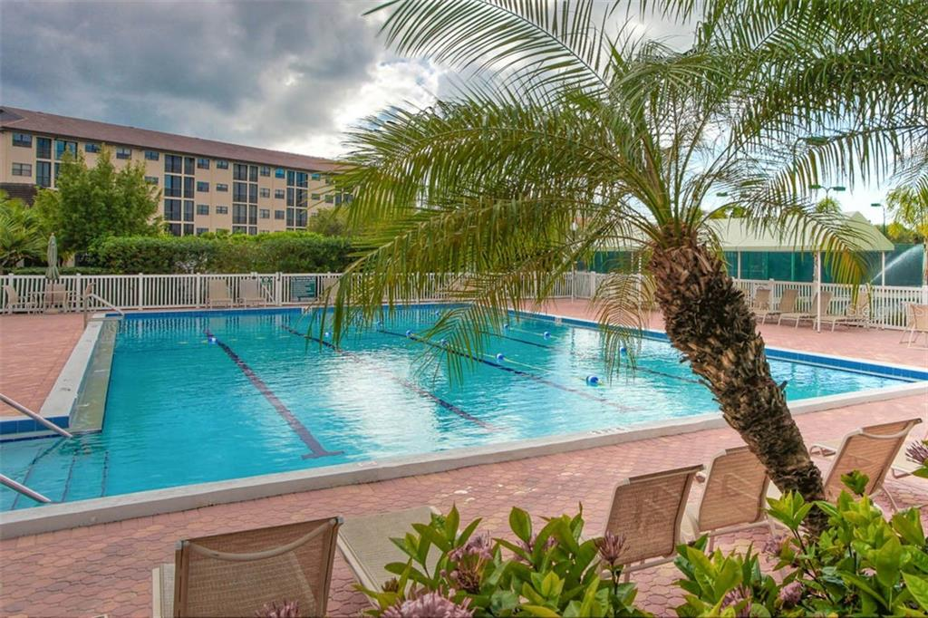 Relax poolside - The Landings includes beautiful community amenities. - Condo for sale at 1716 Starling Dr #204, Sarasota, FL 34231 - MLS Number is A4412237