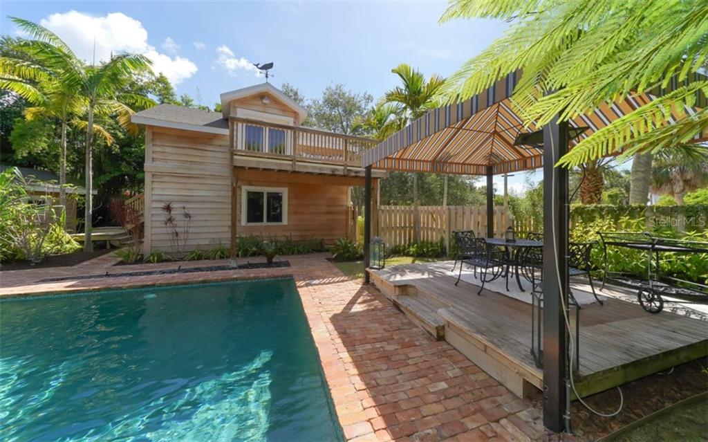 The huge outdoor Cabana features a wood deck, electric and cable.  Perfect for enjoying outdoor activities in a private setting.  THIS IS PARADISE! - Single Family Home for sale at 138 Island Cir, Sarasota, FL 34242 - MLS Number is A4412265