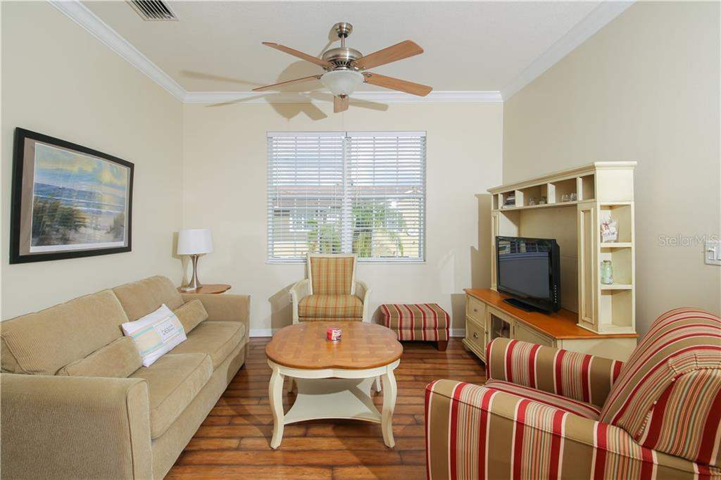 Furnished and move in ready!  Sleeper sofa for guests.  Updated flooring.  Light & airy! - Condo for sale at 7895 Limestone Ln #12-202, Sarasota, FL 34233 - MLS Number is A4412836