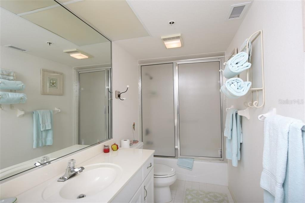 Guest Bedroom with adjoining bath (en-suite) - Condo for sale at 11000 Placida Rd #2304, Placida, FL 33946 - MLS Number is A4413206