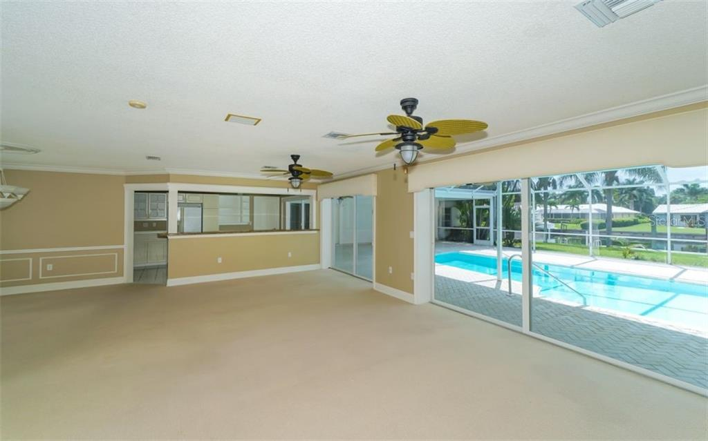 Living room - lots of space and a great view! - Single Family Home for sale at 390 Bob White Dr, Sarasota, FL 34236 - MLS Number is A4413388
