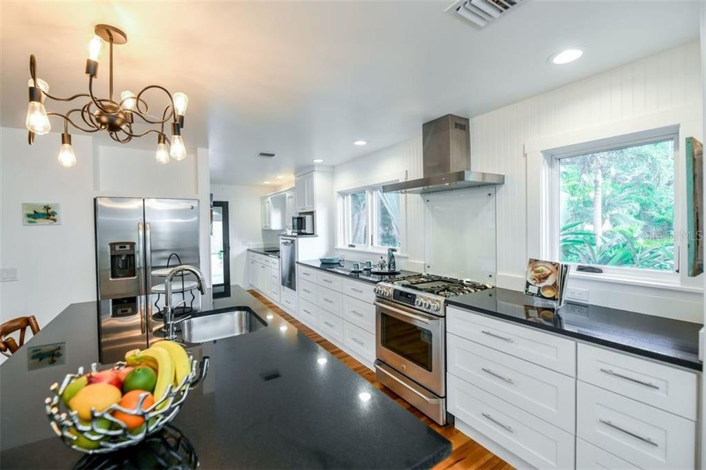 Beautiful, functional kitchen with gas cooking and plenty of counter space to prepare any meal. - Single Family Home for sale at 550 Ohio Pl, Sarasota, FL 34236 - MLS Number is A4414310