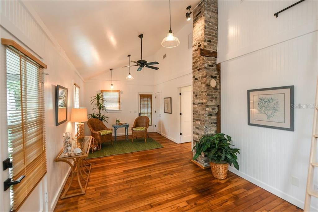 Original 1920's bungalow completed renovated with beautiful wood floors and exposed brick from a previous fireplace. - Single Family Home for sale at 550 Ohio Pl, Sarasota, FL 34236 - MLS Number is A4414310