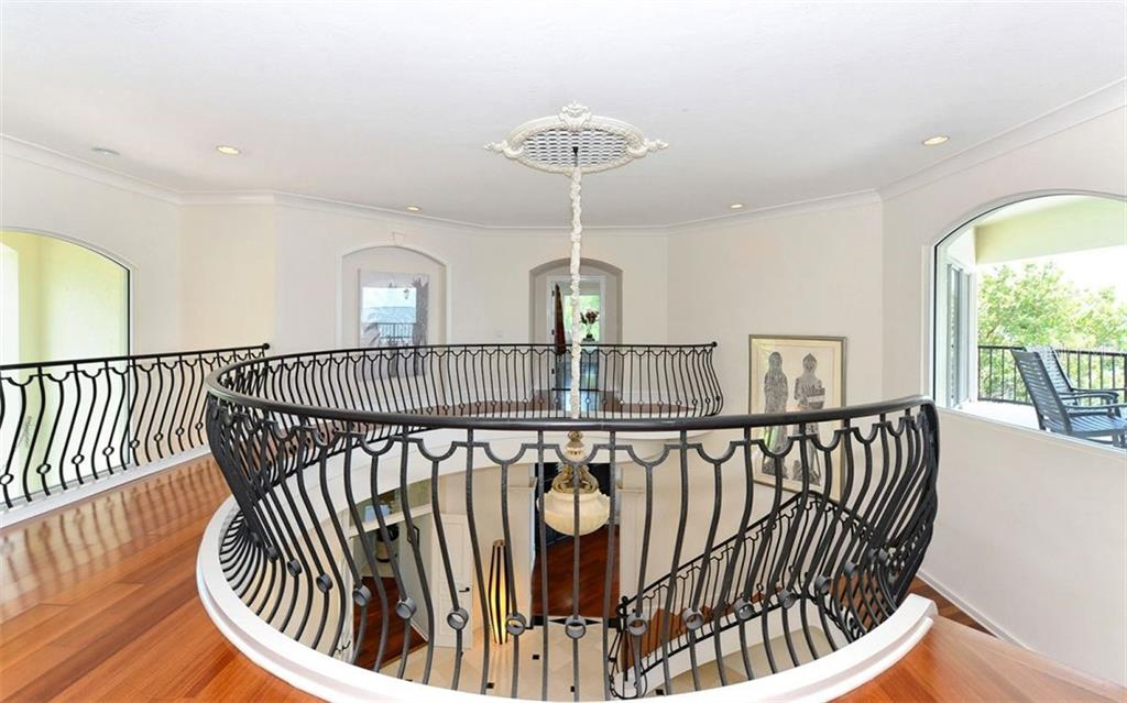Stunning second story common area featuring the grand staircase. - Single Family Home for sale at 2145 Alameda Ave, Sarasota, FL 34234 - MLS Number is A4414337