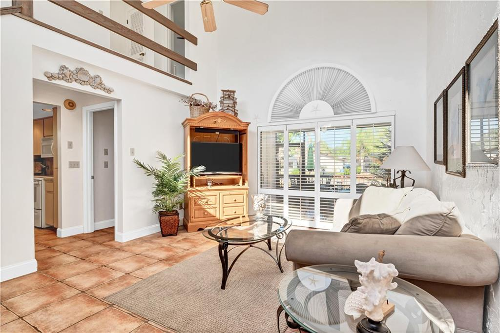 With 2 story high ceilings and a view to the canal, this is a great living area. - Single Family Home for sale at 5214 S Riverview Cir, Homosassa, FL 34448 - MLS Number is A4414387