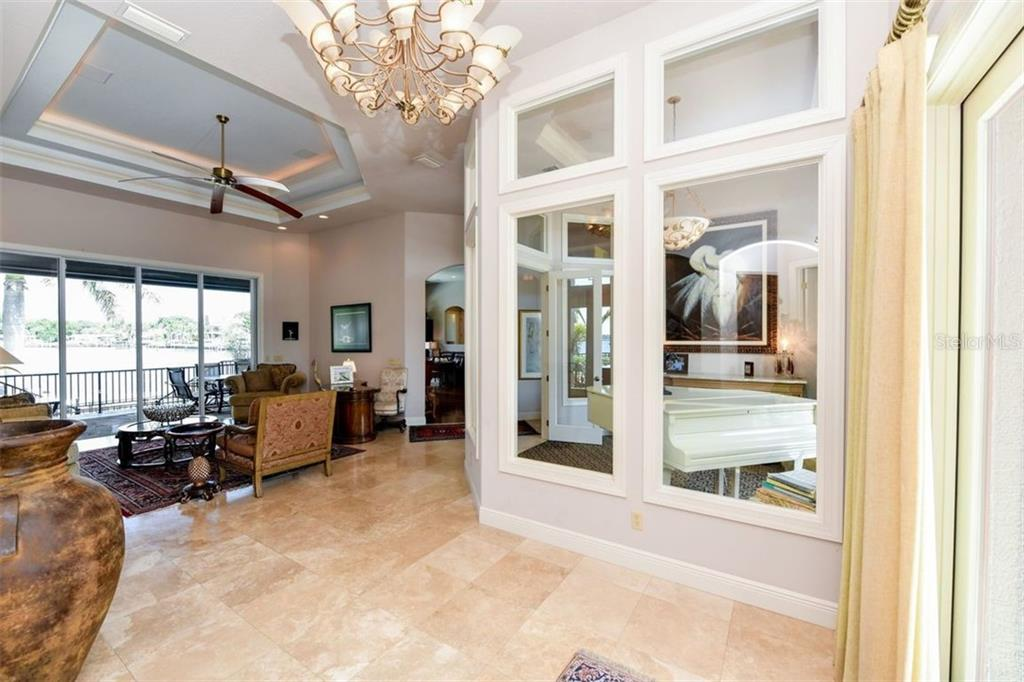 Foyer opens to formal living room and onto lanai. - Single Family Home for sale at 1483 Tangier Way, Sarasota, FL 34239 - MLS Number is A4414757