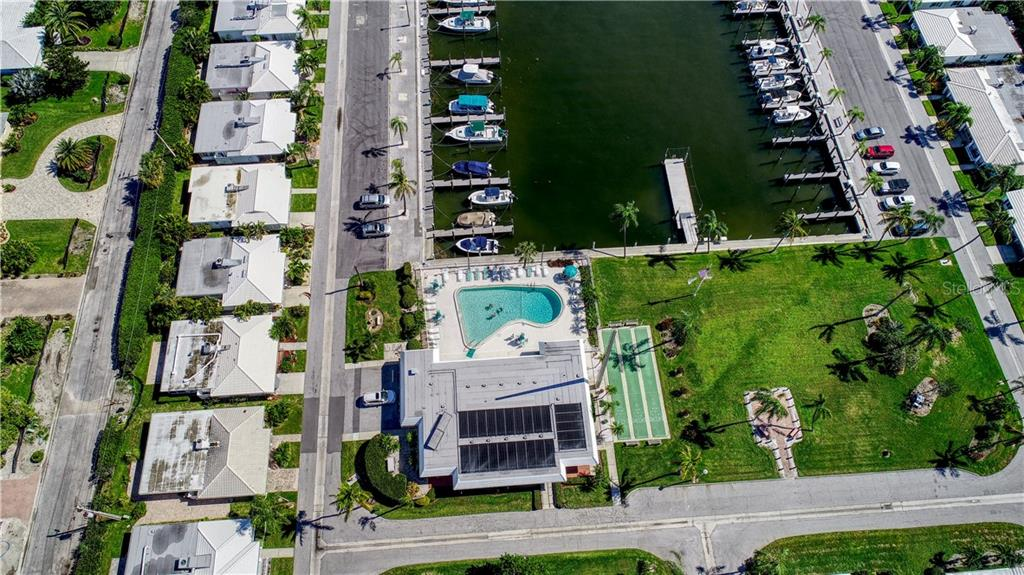 Marina with boat slips. Community pool and clubhouse. - Villa for sale at 682 Spanish Dr S, Longboat Key, FL 34228 - MLS Number is A4414905