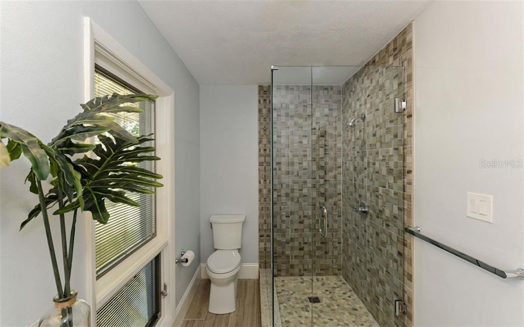 Bath 1 Shower with seamless glass enclosure and door - Single Family Home for sale at 4619 Higel Ave, Sarasota, FL 34242 - MLS Number is A4415833