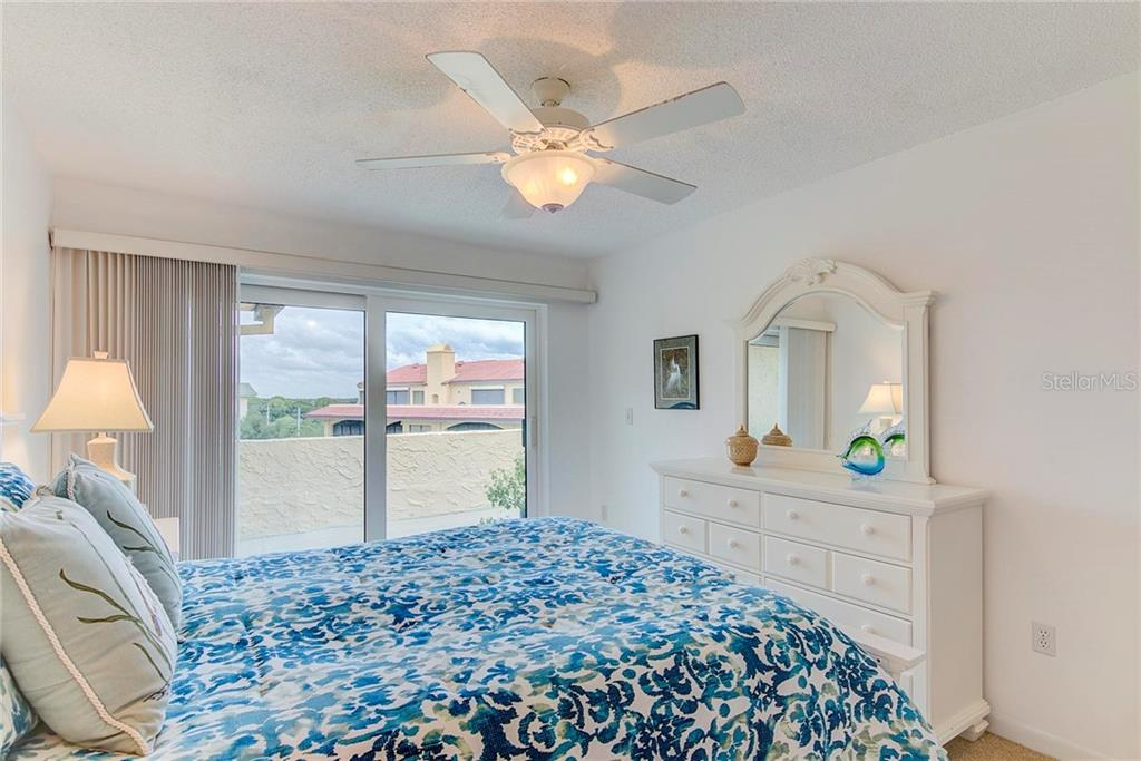 Guest Bedroom 1 - Condo for sale at 8750 Midnight Pass Rd #502c, Siesta Key, FL 34242 - MLS Number is A4416020