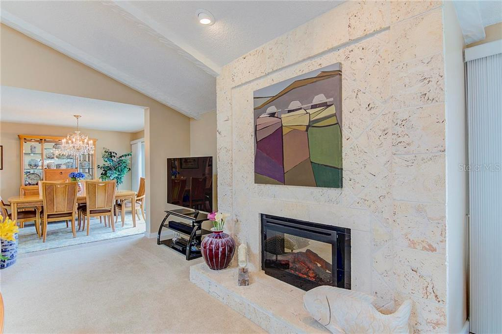 Custom Gas Fireplace for Cool Winter Nights or just for ambience with heat off - Condo for sale at 8750 Midnight Pass Rd #502c, Siesta Key, FL 34242 - MLS Number is A4416020